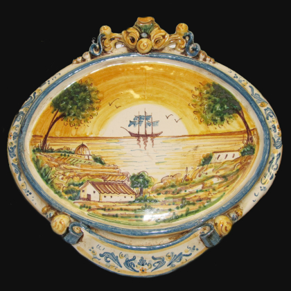Ovale orizzontale medio c/veliero 23x25 blu/arancio in Ceramica Artistica di Caltagirone
